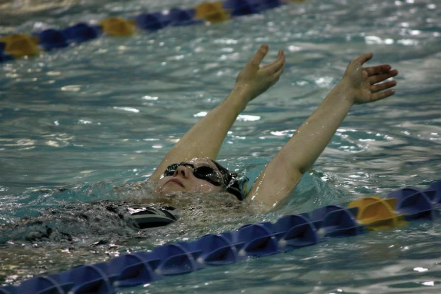 First Year Leah Davis practices the backstroke at practice before the MAC championships. MARY BOVE/THE HIGHLANDER