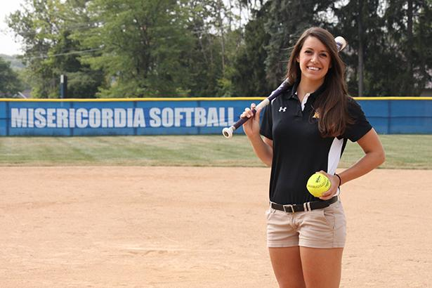 New softball coach Lindsay Freitag poses for a photo on the Anderson softball field.