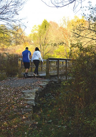 Senior communications major Courtney Garloff and Austin Sullivan walk over one of the bridges on the Upper Deer Trail at Frances Slocum.