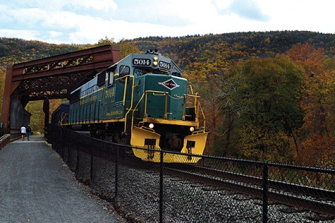 Two girls walk alongside the train as it passes over the bridge. Train rides are 45 minutes in October due to increased popularity and demand.