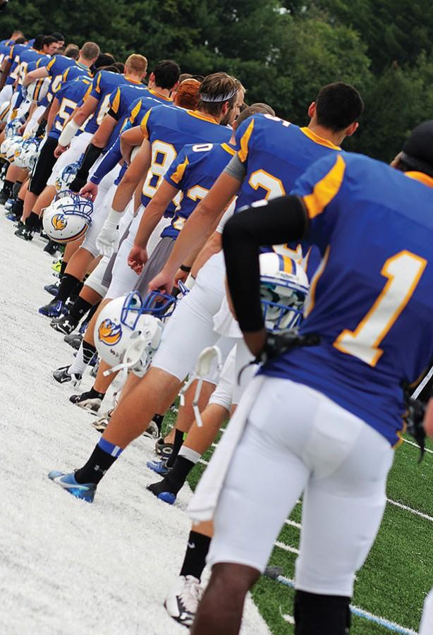 The football team lines up .