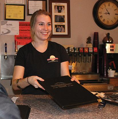 Senior communications major Erin Dougherty working at III Guys Restaurant and Sports Bar.