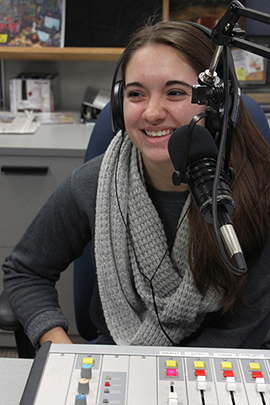 Senior Cougar Radio Music Director Alison Counterman during a radio show.