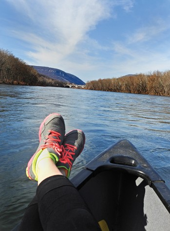 Mathiesen kicks back with her feet up while floating back to the boat launch.