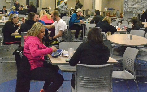 Students enjoy a meal  in the John and Mary Metz dining hall.