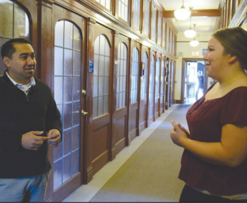 Fomr right to left: Student Kassie Cebula and Assistant Director of Enrollment Management Cheyne Wago meet in the hall of admissions department.