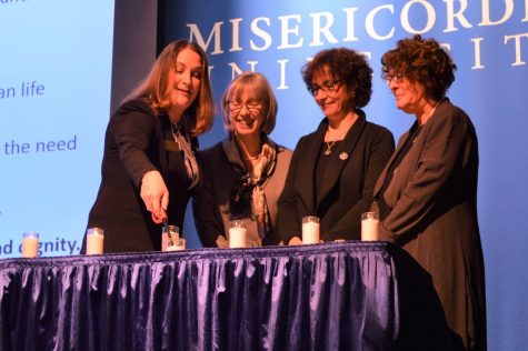 From left to right: Dr. Stacy Gallin, Dorothy Chambers, CANDLES Executive Director, Dr. Tessa Chelouche, and Dr. Susan Miller participating in the candle lighting to remember the victims of the Holocaust and medical abuse.