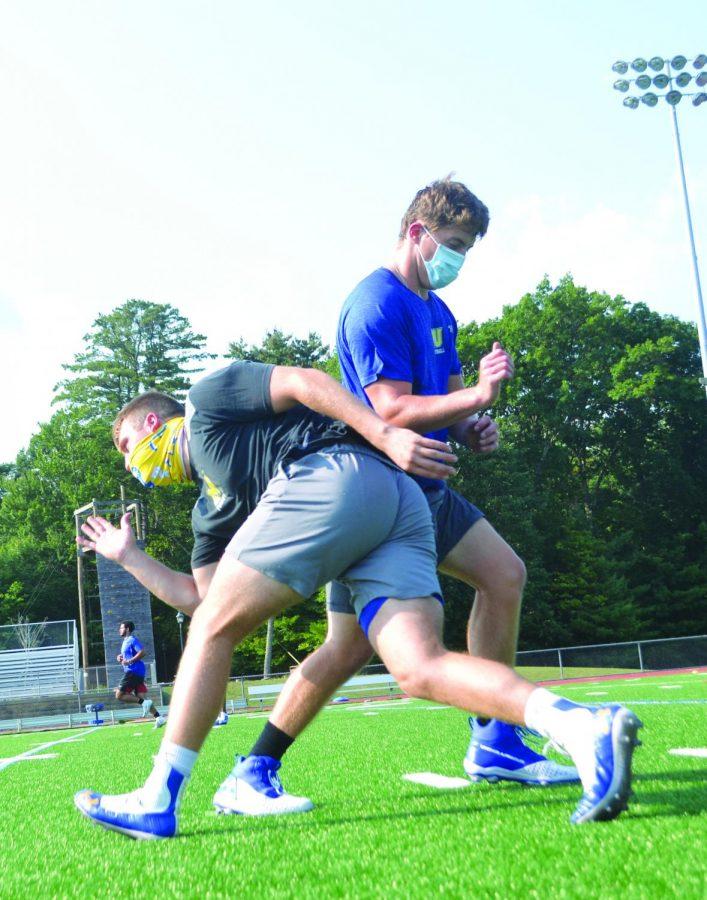 Logan Baxter, left, uses a rip technique to get around the pass set by Matt Carter, right.