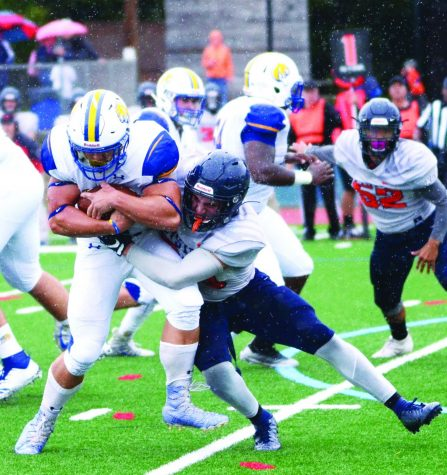 Misericordia protects the ball from the opposing team, earning another first down, during a game versus Keystone College during the fall 2019 semester.