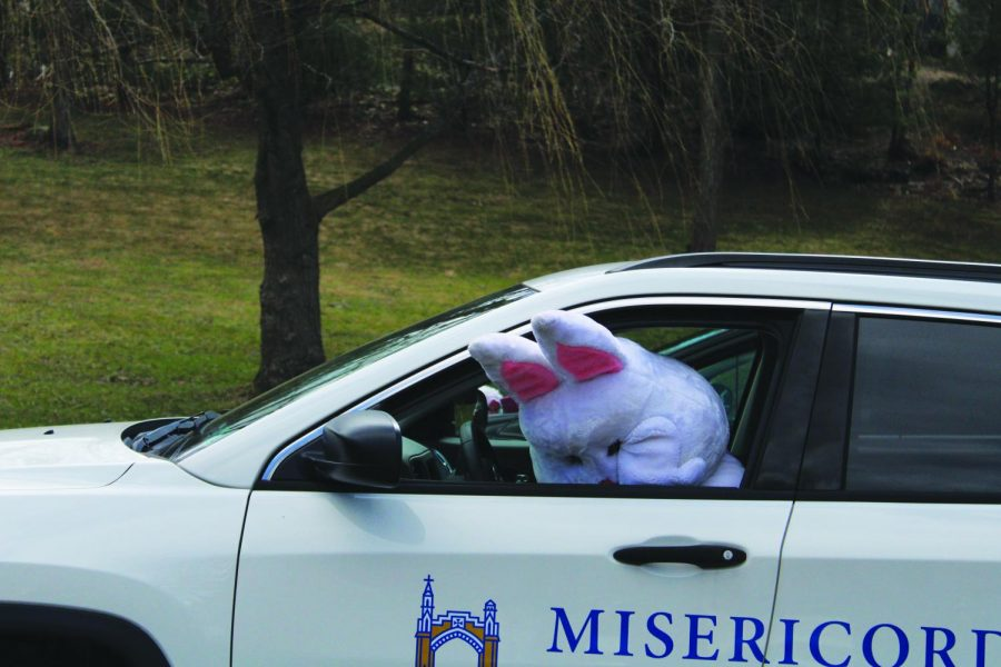 The Easter Bunny says goodbye to the children after the Easter Egg Hunt at Maffett House.