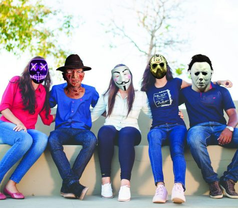 "A group of students pose for a photo with their new masks on. Victor Vendetta, Cougar Care Team member, said the students' response on the new masks has been ""overwhelmingly positive."""