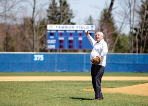 Robert L. Tambur, chairman and CEO of Tammac Financial Corp., throws out the first pitch of doubleheader game at Misericordia University as part of the dedication of Tambur Field.