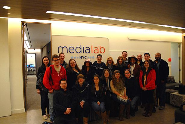 Students pose for a group photo outside of the TIme Warner Media Lab in New York City.