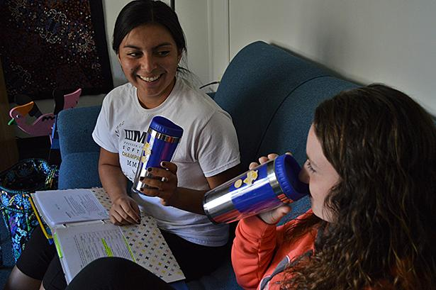 Junior speech lanuage pathology major Alissa Steier and junior physical therapy major Mackenzie Yurko drink from their new to-go cups while doing homework.