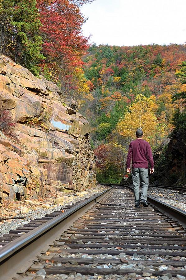 Tyler Bartron checks out the train tracks off of the Glen Onoko Falls Trail.