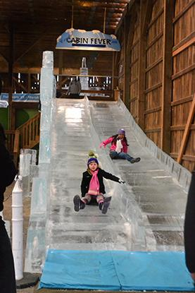 A 50 foot ice slide is open for all ages to enjoy.