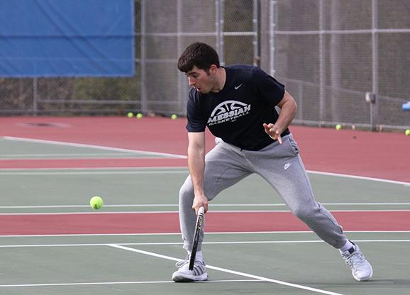 Sophomore doctor of physical therapy major gets ready to hit the ball back across the court.