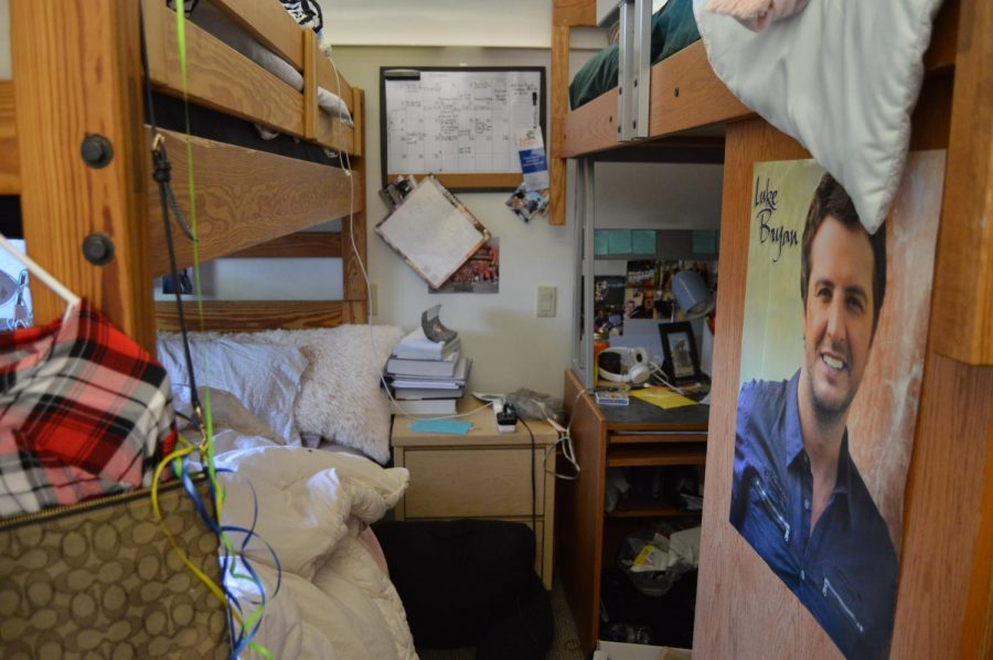 A cramped triple room located in McHale Hall.