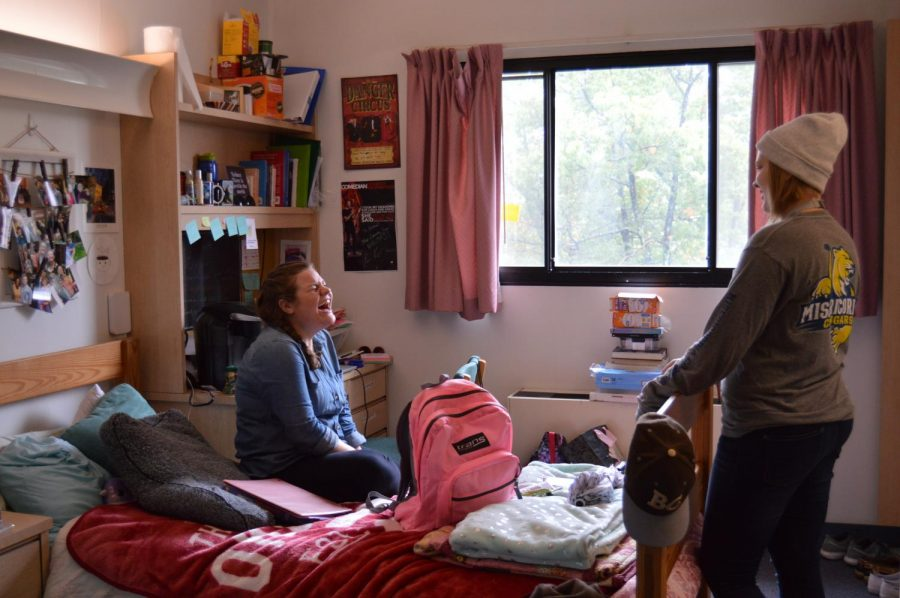 From left to right:  Lauren Schuster, first year speech language pathology major, and Jennifer Klobe, first year occupational therapy student in their traditional-style room in McHale Hall.