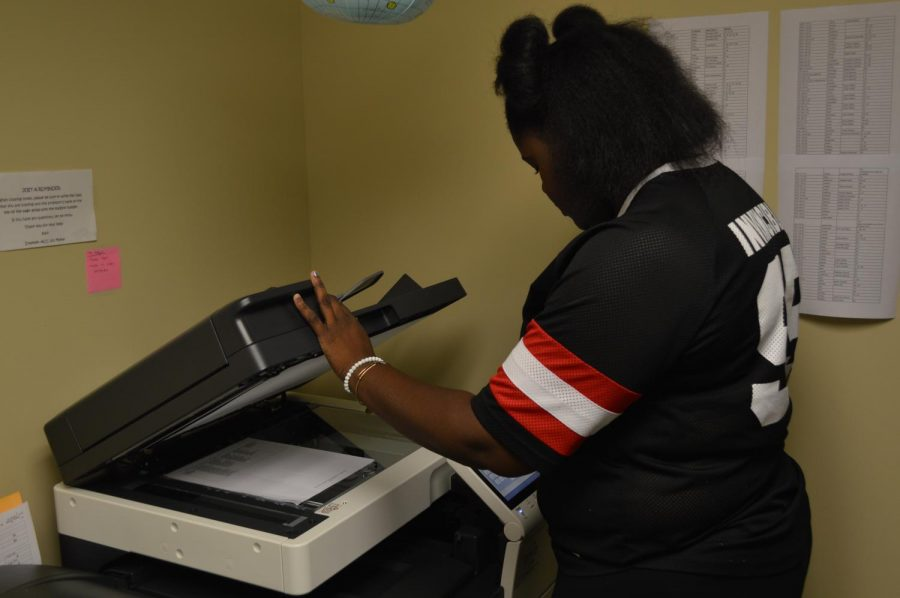 Iana Davis, sophomore communications major, copying notes at the Student Success Center.