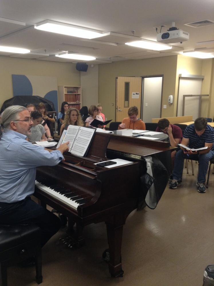 Members of the Community Choir practicing together in the Insalaco Ensemble room.