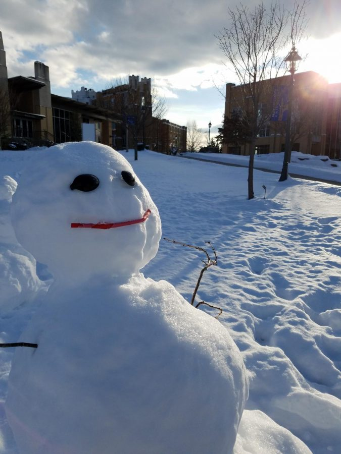 Students+get+creative+while+making+a+snowman+during+a+recent+snowfall.+Coal+isn%27t+necessary+when+you+have+spoons+and+a+straw%21