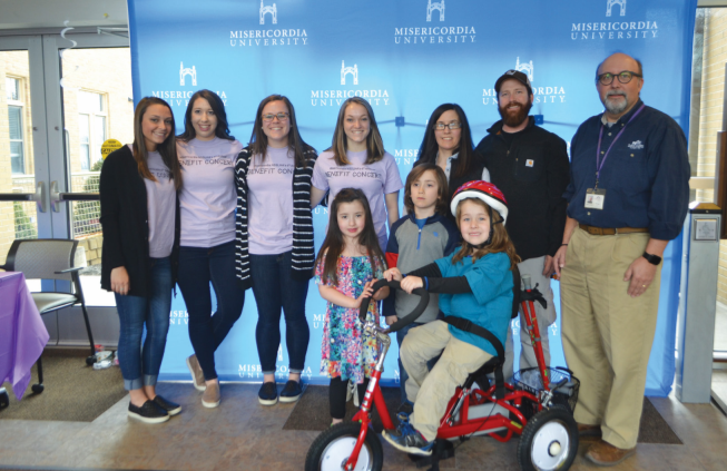 Front row left to right: Lucy Olmsted, Isaac Olmsted, Jacob Olmsted. Back row from left to right: Alexis D'Amico (NSSLHA Vice President), Samantha Olcott (treasurer), Megan Kieltyka (secretary), Jenna Reed (president), Nikki Nardell, Jason Olmsted, Mike Kane - director of Therpeatic Services for St. Joseph's Center.