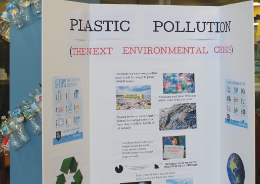 A poster board warns against excess plastic usage.