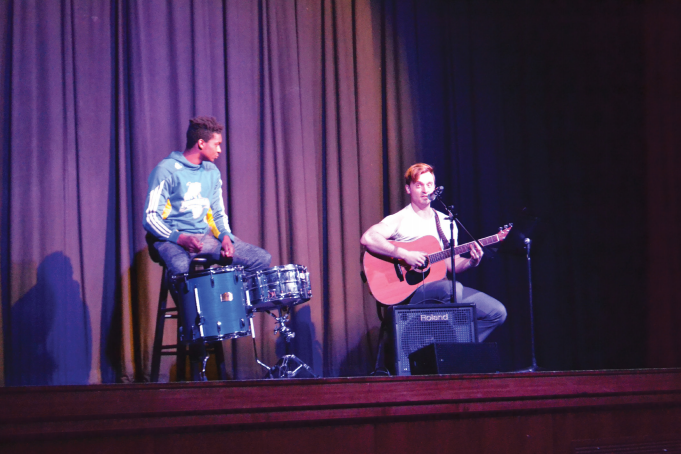 Mike Ryan and his friend singing and playing guitar for his talent portion.
