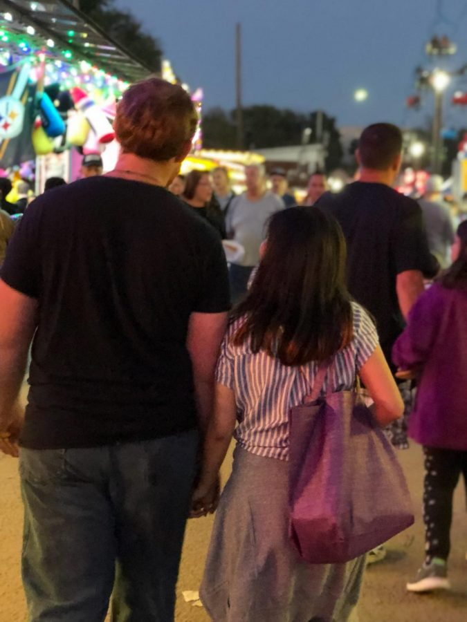 Jacob Schwieger, graduate physical therapy major, and Annette Ritzko, graduate speech-language pathology major, enjoy the sights and sounds of the Bloomsburg Fair