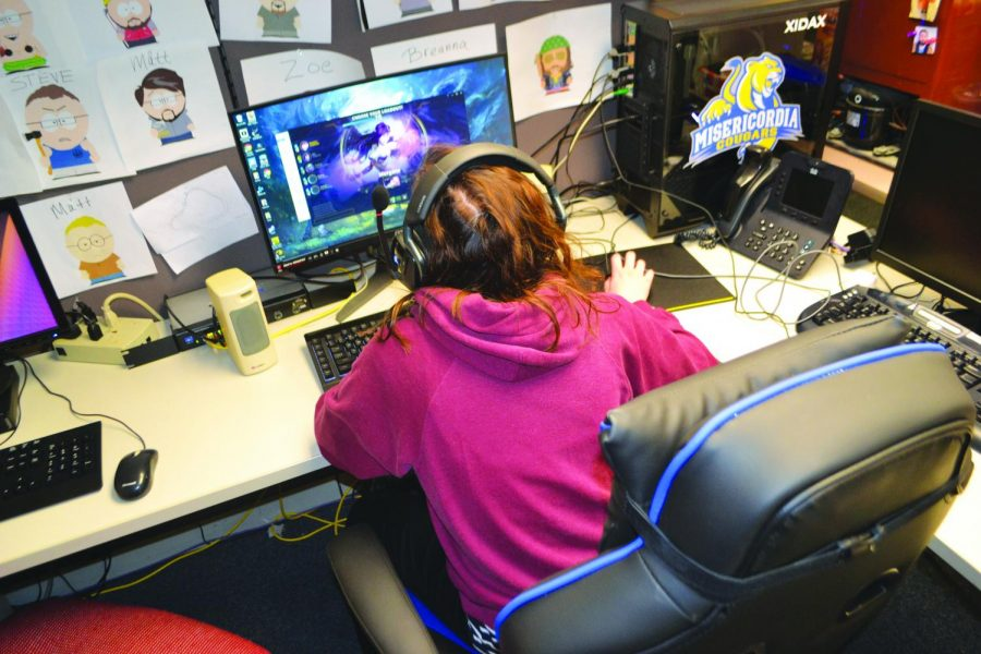 Above, senior English and mass communication major, Zoe Laporte, playing 'League of legends.'