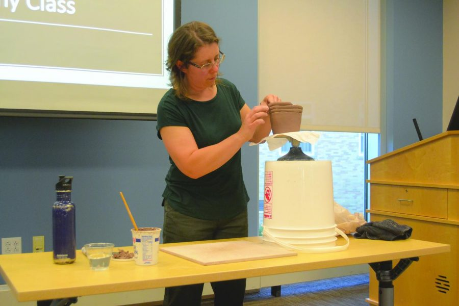 Cathleen+Repholz%2C+ceramics+professor%2C+demonstrates+the+proper+way+to+form+a+pot.+She+has+been+involved+in+ceramics+for+10+years.+