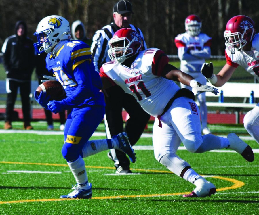 From left to right: Misericordia's #24 Running Back, junior Michael Gawlik, runs with the ball away from Albright University's #11 on Saturday, Nov. 9, 2019