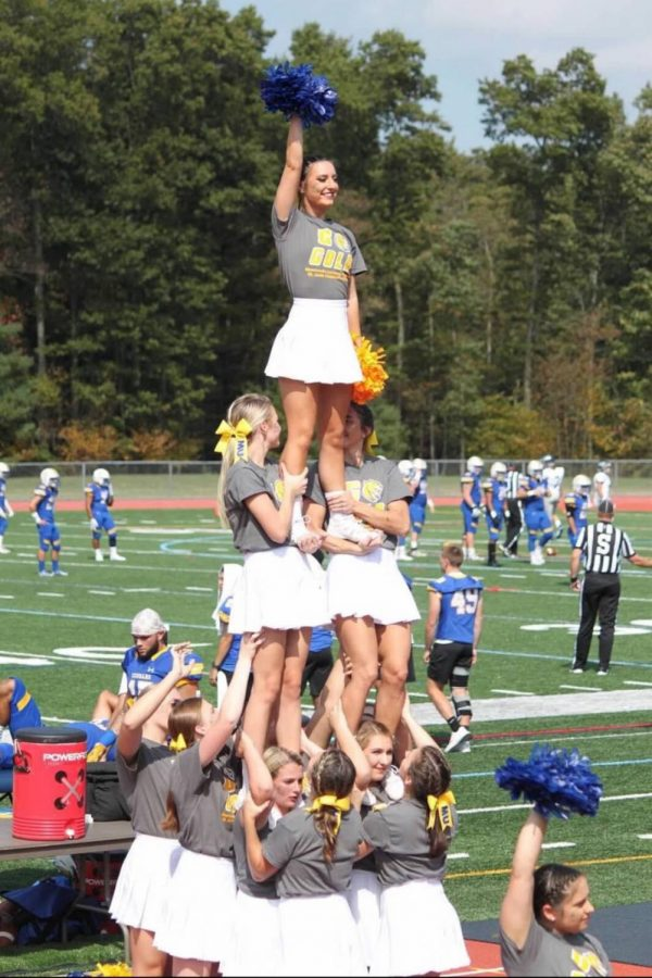 The team entertains the crowd with a pyramid stunt during a home game.