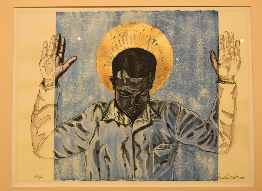 """A piece titled """"Hands Up-Nimbus"""" by Curlee Raven Holton, who helped curate """"The Fine Print"""" exhibit, hangs in the Pauly Friedman Art Gallery. Holton created it to bring awareness to bring more awareness to the discrimination faced by Black people."""