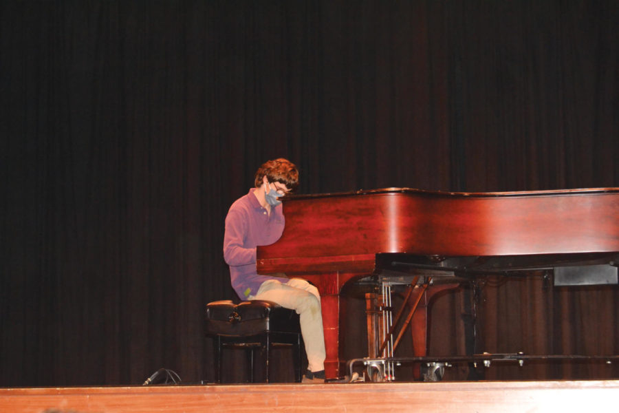 Aiden McCarthy (Senior, Mass Commuications) performs an improvised piece on the piano as part of the Homecoming Talent show.